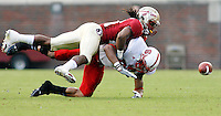 TALLAHASSEE, FL 10/31/09-FSU-NCST FB09 CH12-Florida State's Patrick Robinson collides with N.C. State's Donald Bowens as the pass intended for Bowens falls away during first half action Saturday at Doak Campbell Stadium in Tallahassee. .COLIN HACKLEY PHOTO