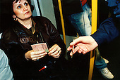 A woman shows her ticket to a controller in the Berlin metro..Picture taken 2005 by Justin Jin
