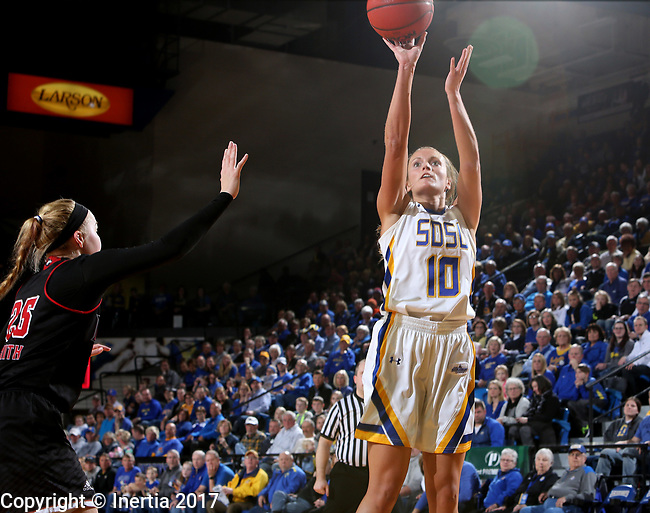 BROOKINGS, SD - MARCH 16:  Kerri Young #10 from South Dakota State University shoots against Kelly Smith #25 from Northern Illinois during their first round WNIT game Thursday at Frost Arena in Brookings.(Photo by Dave Eggen/Inertia)