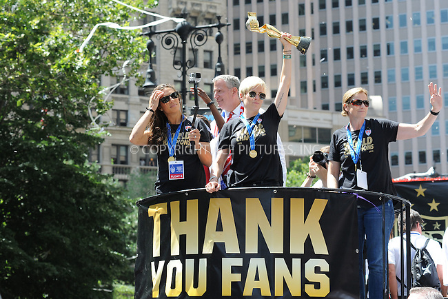 WWW.ACEPIXS.COM<br /> July 10, 2015 New York City<br /> <br /> Carli Lloyd, Mayor Bill de Blasio,Megan Rapinoe and  U.S. Coach Jill Ellis aboard a float in the New York City Ticker Tape Parade for World Cup Champions U.S.A. Women's Soccer National Team on July 10, 2015 in New York City.<br /> <br /> <br /> Credit: Kristin Callahan/ACE Pictures<br /> <br /> Tel: 646 769 0430<br /> e-mail: info@acepixs.com<br /> web: http://www.acepixs.com