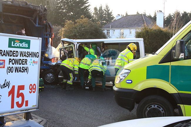 The scene of an accident between a mini bus and a rubbish lorry outside the Black Bull on the Dublin road. The front seat passenger had to be cut from the mini bus after it collided with the rear of the Lorry. It took the fire service nearly 45 minutes to remove the casualty before she was transported to Our lady of Lourdes hospital. The scene remained closed for a number of hours pending a garda investigation..Picture Fran Caffrey/Newsfile.ie