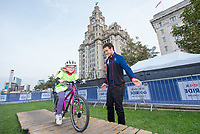 Picture by Allan McKenzie/SWpix.com - 24/09/2017 - Cycling - HSBC UK City Ride Liverpool - Albert Dock, Liverpool, England - Steven Burke helps young riders through the Go-Ride course.