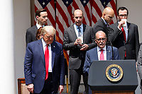 United States President Donald J. Trump, lower left, reacts as Director of the National Economic Council Larry Kudlow, lower right, speaks in the Rose Garden of the White House in Washington, DC on June 5, 2020. <br /> Credit: Yuri Gripas / Pool via CNP/AdMedia