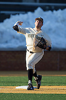 Wake Forest Demon Deacons third baseman Will Craig (22) makes a throw to first base against the Towson Tigers at Wake Forest Baseball Park on February 15, 2014 in Winston-Salem, North Carolina.  The Tigers defeated the Demon Deacons 5-4.  (Brian Westerholt/Four Seam Images)