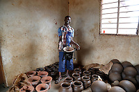 Hussein D'Oto, an artisan potter making a 'clean cookstove' in Tanzania.<br /> <br /> Hussein has been making clay pots for 18 years, but has recently received training in how to also make 'clean cookstoves', as part of a UK-supported programme being implemented by the Dutch NGO SNV. <br /> <br /> The clean cookstoves can use wood or charcoal for fuel, but use less of either, and produce less smoke, than traditional open fire cooking - meaning they're more fuel efficient, and less harmful in terms of the fumes they emit. This in turn means that people have to spend less money on buying charcoal, less time collecting firewood, and are less exposed to smoke and fumes that affect their health.<br /> <br /> Hussein is already using one of the cookstoves in his own home, and can already produce up to 50 clay stoves per day. He's now looking to partner with a local metal worker, so that they can be clad and then sold in larger towns where there is lots of demand for them.<br /> <br /> The SNV project ensures consistent quality of cookstoves through training and the introduction of standardised production methods. since the start of the project in 2012, about 28,500 people have benefitted from clean cookstoves across Tanzania's Lake Zone.  <br /> <br /> Picture: Russell Watkins/Department for International Development