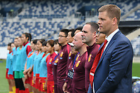 26 November 2017, Melbourne - SIGURDUR EYJOLFSSON coach of China PR stands for the national anthem during an international friendly match between the Australian Matildas and China PR at GMHBA Stadium in Geelong, Australia.. Australia won 5-1. Photo Sydney Low