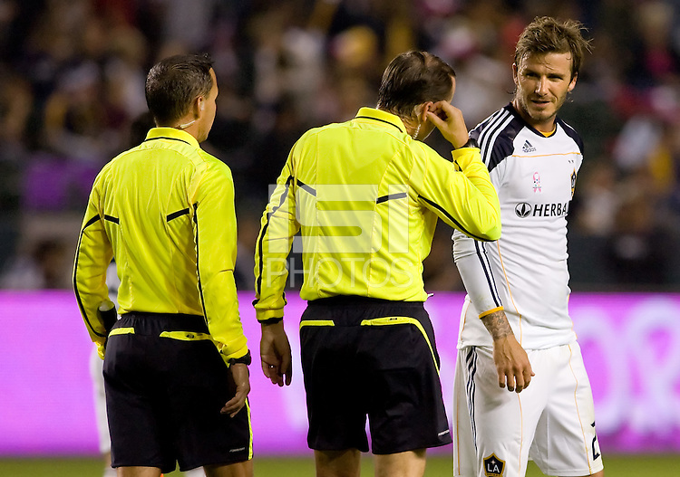 David Beckham of the LA Galaxy and referee Kevin Stott share a few words with one another on the way to the tunnel at half time. The Colorado Rapids defeated the LA Galaxy 3-1 at Home Depot Center stadium in Carson, California on Saturday October 16, 2010.