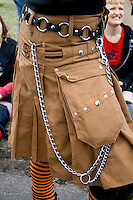Chained kilt uniformed RollerGirl from the Roller Derby League. MayDay Parade and Festival. Minneapolis Minnesota USA