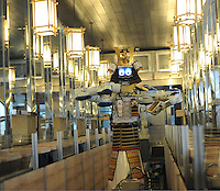 Samurai robot waiter slides in the Hajime Restaurant, out-skirts of Bangkok, Thailand. Hajime is a Japanese restaurant in Thailand, has samurai style robot serving food to the diners and even do a dance session to entertain guests. This robot are made in Japan and costed about 86,600,000 yen (1,063,717USD). Customers order food from touch panel and Samurai robot will bring ordered food to their table.<br />