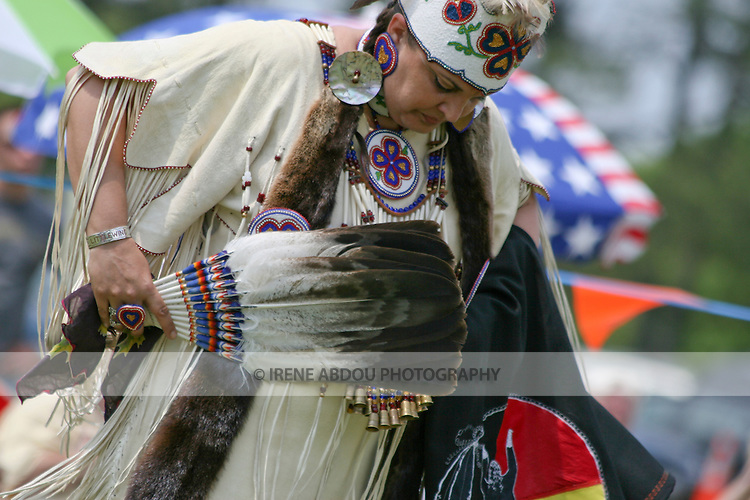 A Native American dancer carries a fan, beaded ring, and her grandmother's antique hankie at the 8th Annual Red Wing Native American PowWow.