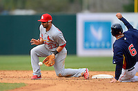 St. Louis Cardinals second baseman Daniel Descalso #33 blocks a throw in the dirt as Jason Jaramillo #6 slides in during a Spring Training game against the Houston Astros at Osceola County Stadium on March 1, 2013 in Kissimmee, Florida.  The game ended in a tie at 8-8.  (Mike Janes/Four Seam Images)