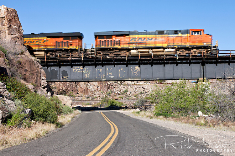 A Burlington Northern Freight Train passes over the National Old Trails Road and Route 66 west of Kingman, Arizona.