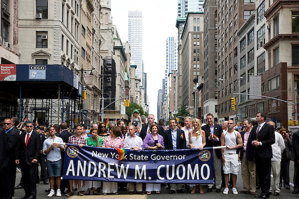 New York Mayor Michael Bloomberg (C), City Council Speaker Christine Quinn (4R), Governor Andrew Cuomo (3R), and Sandra Lee (2R) participate in the 2011 NYC Pride March on 26 June 2011 in New York, New York, two days after the New York State Senate voted 33-29 to legalize gay marriage.