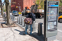 New York, NY - Department of Transportation workers installing a BikeShare station on Washington Square East.