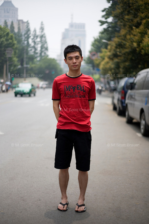 Chenqi, an independent worker, age 24, poses for a portrait in Nanjing. Response to 'What does China mean to you?': 'My own mother country.'  Response to 'What is your role in China's future?': 'Luxurious.'