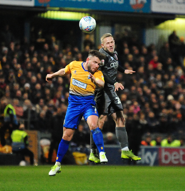 Lincoln City's Danny Rowe battles with Mansfield Town's Alex MacDonald<br /> <br /> Photographer Andrew Vaughan/CameraSport<br /> <br /> The EFL Sky Bet League Two - Mansfield Town v Lincoln City - Monday 18th March 2019 - Field Mill - Mansfield<br /> <br /> World Copyright © 2019 CameraSport. All rights reserved. 43 Linden Ave. Countesthorpe. Leicester. England. LE8 5PG - Tel: +44 (0) 116 277 4147 - admin@camerasport.com - www.camerasport.com
