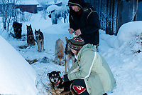 Volunteer veterinarians James Kenyon and Jennifer Pearson tend to the return dogs the Kaltag checkpoint on Monday morning March 11th during the 2019 Iditarod Trail Sled Dog Race.<br /> <br /> Photo by Jeff Schultz/  (C) 2019  ALL RIGHTS RESERVED