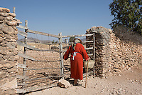 Morocco - Tidzi - Nina Amchine, 52, from Idmine, founder of Ajddigue closes the gate of her house before heading to the Argan forest. Born in 1997 out of the initiative of 17 women, Ajddigue is one of the oldest cooperatives in the area. Since its creation, Ajddigue has benefited more than 100 local women by employing them in the argan oil extraction and enrolling them in alphabetisation courses.