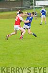 Kerins O'Reilly John Ferguson and Daingean Uí Chúis Seán Ó Brosnacháin in an action during the County League Div.1 match at Páirc an Ághasaigh, Dingle, on Sunday afternoon.