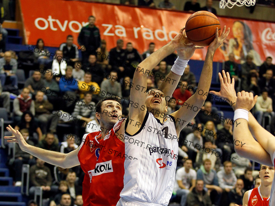 Kosarka, ABA League, season 2010/2011.Partizan Vs. Crvena Zvezda Beograd.Dusan Kecman, right and Mile Ilic, left.Belgrade, 25.12.2011..foto: Srdjan Stevanovic/Starsportphoto.com ©