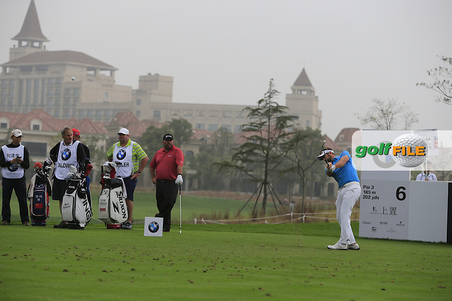 Matthew Baldwin (ENG) tees off the 6th tee during Saturay's Round 3 of the 2014 BMW Masters held at Lake Malaren, Shanghai, China. 1st November 2014.<br /> Picture: Eoin Clarke www.golffile.ie