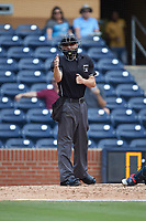 Home plate umpire Dan Merzel makes a strike call during the International League game between the Columbus Clippers and the Durham Bulls at Durham Bulls Athletic Park on June 1, 2019 in Durham, North Carolina. The Bulls defeated the Clippers 11-5 in game one of a doubleheader. (Brian Westerholt/Four Seam Images)