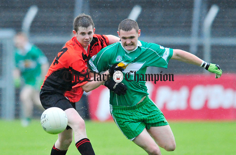 Ballyvaughan's Jack Queally fights for posession with Stephen Mc Inerney of Wolfe Tones. Photograph by Declan Monaghan
