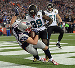 (Foxboro, MA, 01/21/18) New England Patriots wide receiver Danny Amendola, left, stays inbounds after hauling in the go ahead touchdown past Jacksonville Jaguars' Tashaun Gipson and Paul Posluszny during the fourth quarter of the AFC championship NFL football game at Gillette Stadium on Sunday, January 21, 2018. Photo by Christopher Evans