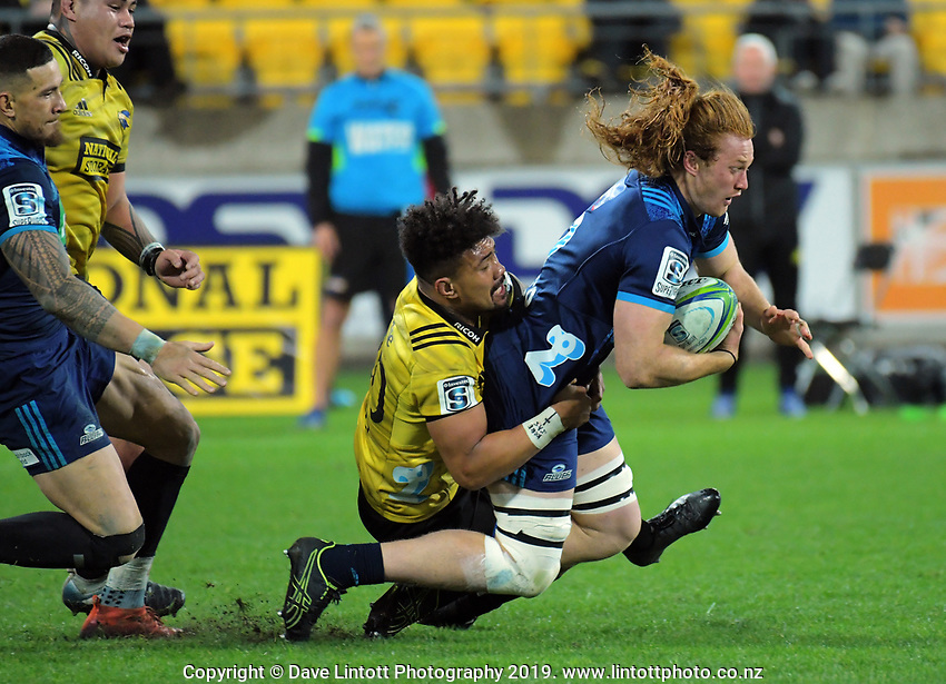 Ardie Savea tackles Tom Robinson during the Super Rugby match between the Hurricanes and Blues at Westpac Stadium in Wellington, New Zealand on Saturday, 15 June 2019. Photo: Dave Lintott / lintottphoto.co.nz