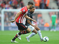 Burnley's Aaron Lennon under pressure from Southampton's Jack Stephens<br /> <br /> Photographer Kevin Barnes/CameraSport<br /> <br /> The Premier League - Southampton v Burnley - Sunday August 12th 2018 - St Mary's Stadium - Southampton<br /> <br /> World Copyright &copy; 2018 CameraSport. All rights reserved. 43 Linden Ave. Countesthorpe. Leicester. England. LE8 5PG - Tel: +44 (0) 116 277 4147 - admin@camerasport.com - www.camerasport.com
