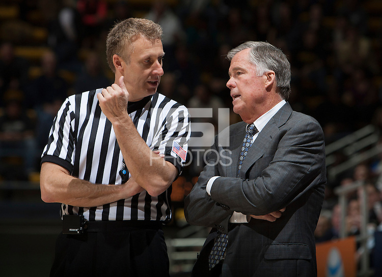 California head coach Mike Montgomery talks with the referee about a bad call during the game against UC Irvine at Haas Pavilion in Berkeley, California on December 2nd, 2013.  California defeated UC Irvine, 73-56.