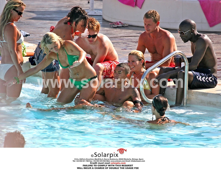 EXCLUSIVE ALL ROUND PICTURES FROM SOLARPIX.COM. .*UK SUNDAY PAPERS ONLY*.**MUST AGREE FEE BEFORE PUBLICATION**.***WORDS BY TOM WORDEN***.England international Ashley Cole in Marbella on Spain's Costa del Sol for his stag party weekend with Tottenham's Jermaine Jenas and other stars from the sport of football. Job Ref: 2555/AB1. 06.07.06.  .MUST CREDIT SOLARPIX.COM OR DOUBLE FEE WILL BE CHARGED..