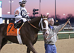 Will Take Charge, with jockey Luis Saez, being led into the winner's circle by owner Willis Horton after his G1 Clark Handicap victory.<br /> November 29, 2013.