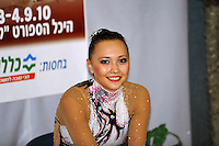 "Anna Alyabyeva of Kazakhstan smiles to camera at ""kiss & cry"" during event finals at 2010 Holon Grand Prix at Holon, Israel on September 4, 2010.  (Photo by Tom Theobald)."