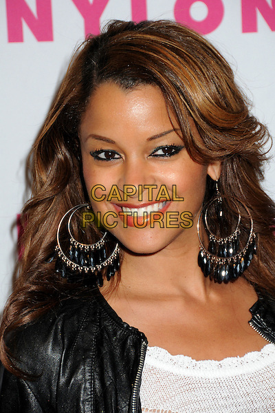 CLAUDIA JORDAN.Nylon Magazine's Young Hollywood Party held at the Roosevelt Hotel's Tropicana Bar, Hollywood, California, USA..May 12th, 2010.headshot portrait black white top leather hoop earrings gold eyeliner make-up red lipstick.CAP/ADM/BP.©Byron Purvis/AdMedia/Capital Pictures.