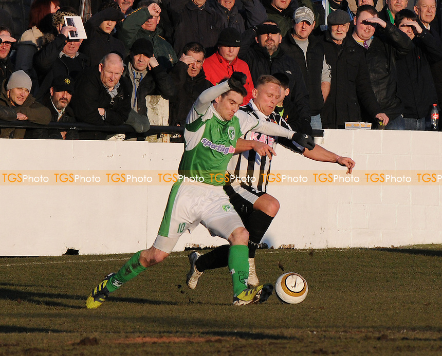 Guernsey's Ross Allen battles with Spennymoor Town Kallum Griffiths - Spennymoor Town vs Guernsey - FA Challenge Vase Semi-Final 2nd Leg at The Brewery Field - 30/03/13 - MANDATORY CREDIT: Steven White/TGSPHOTO - Self billing applies where appropriate - 0845 094 6026 - contact@tgsphoto.co.uk - NO UNPAID USE.