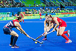 Lily Owsley #26 of Great Britain is tackled by Michelle Vittese #9 of United States and Julia Reinprecht #12 of United States during Great Britain vs USA in a women's Pool B game at the Rio 2016 Olympics at the Olympic Hockey Centre in Rio de Janeiro, Brazil.