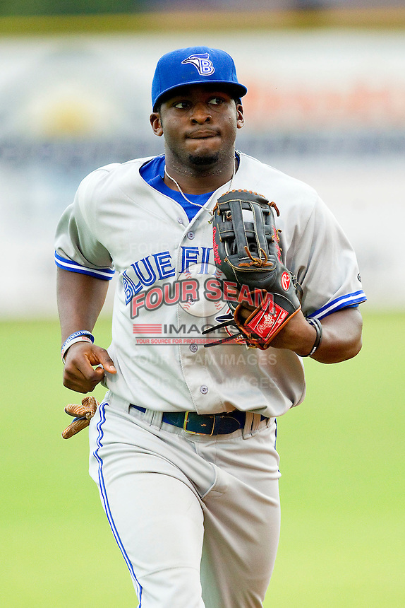 Bluefield Blue Jays center fielder Dwight Smith Jr. #25 jogs off the field between innings of the Appalachian League game against the Elizabethton Twins at Joe O'Brien Field on July 14, 2012 in Elizabethton, Tennessee.  The Twins defeated the Blue Jays 4-0.  (Brian Westerholt/Four Seam Images)