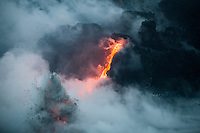 Lava flows into the ocean at dawn in Kalapana, Big Island.