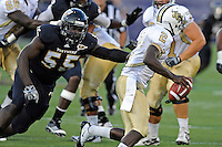 17 September 2011:  FIU linebacker Gregory Hickman (55) pursues UCF quarterback Jeff Godfrey (2) in the second quarter as the FIU Golden Panthers defeated the University of Central Florida Golden Knights, 17-10, at FIU Stadium in Miami, Florida.