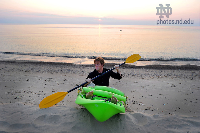 Author James Kennedy on a Lake Michigan beach.  For Notre Dame Magazine..Photo by Matt Cashore/University of Notre Dame