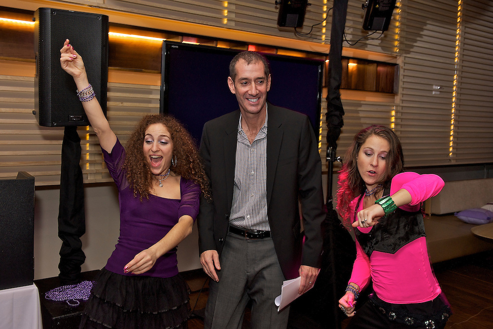 The Bat Mitzvah girl's dad with a couple of the pro dancers.