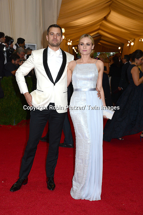 Joshua Jackson and Diane Kruger attends the Costume Institute Benefit on May 5, 2014 at the Metropolitan Museum of Art in New York City, NY, USA. The gala celebrated the opening of Charles James: Beyond Fashion and the new Anna Wintour Costume Center.