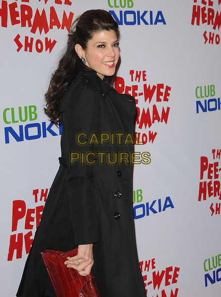 MARISA TOMEI.The The Pee-Wee Herman Show Opening Night held at Club Nokia at L.A. Live in Los Angeles, California, USA..January 20th, 2010.half length dress jacket black red croc animal embossed clutch bag looking over shoulder.CAP/RKE/DVS.©DVS/RockinExposures/Capital Pictures.