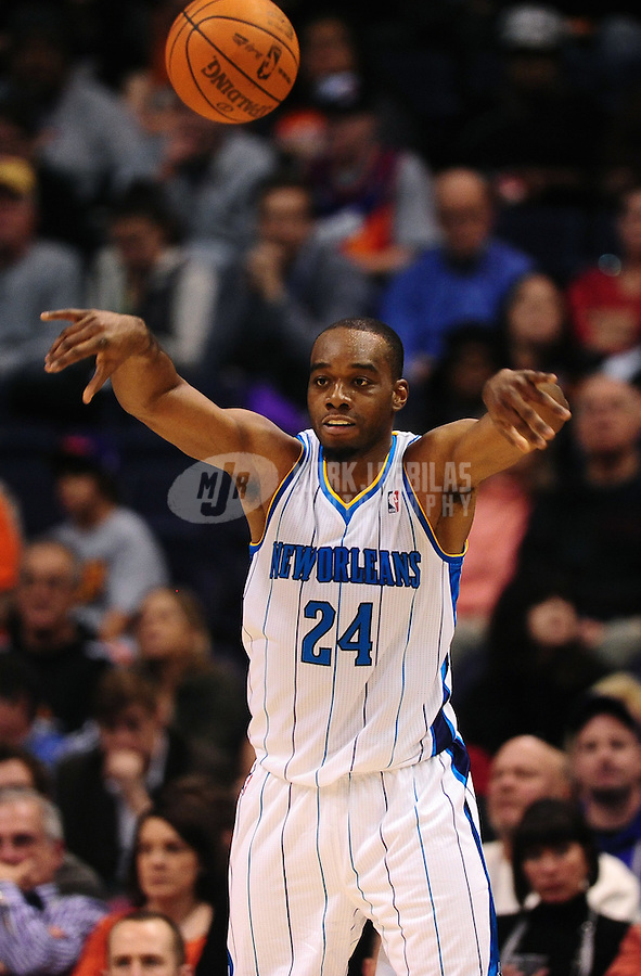 Dec. 26, 2011; Phoenix, AZ, USA; New Orleans Hornets forward Carl Landry passes the ball during game against the Phoenix Suns at the US Airways Center. The Hornets defeated the Suns 85-84. Mandatory Credit: Mark J. Rebilas-USA TODAY Sports