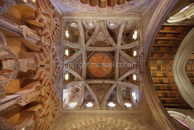 Ceiling of the Villaviciosa Chapel, built under Alfonso X in the 13th century, with 8 ribs intersecting, central dome and shell shapes, in the Cathedral-Great Mosque of Cordoba, in Cordoba, Andalusia, Southern Spain. This chapel served as the sanctuary until the 16th century cathedral was built. The first church built here by the Visigoths in the 7th century was split in half by the Moors, becoming half church, half mosque. In 784, the Great Mosque of Cordoba was begun in its place and developed over 200 years, but in 1236 it was converted into a catholic church, with a Renaissance cathedral nave built in the 16th century. The historic centre of Cordoba is listed as a UNESCO World Heritage Site. Picture by Manuel Cohen
