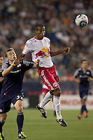 New York Red Bulls defender Roy Miller (7) heads the ball as New England Revolution midfielder Zak Boggs (33) defends. In a Major League Soccer (MLS) match, the New England Revolution tied New York Red Bulls, 2-2, at Gillette Stadium on August 20, 2011.
