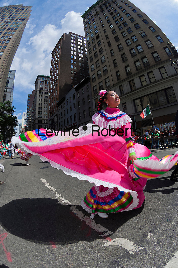 A folk dancing troupe performs on Madison Avenue in New York on Sunday, September 16, 2012 in the annual Mexican Independence Day Parade. The parades that take place from the spring into the fall in New York celebrate the cultural diversity of the city. (© Richard B. Levine)