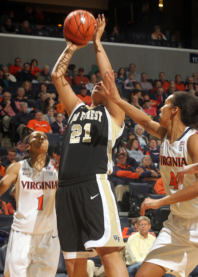 Feb. 3, 2011; Charlottesville, VA, USA; Wake Forest Demon Deacons forward Sandra Garcia (21) shoots between Virginia Cavaliers guard China Crosby (1) and Virginia Cavaliers center Simone Egwu (4) during the game at the John Paul Jones Arena.  Mandatory Credit: Andrew Shurtleff