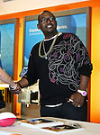 American Idol judge Randy Jackson signs autographs before Super Bowl XLV in Arlington,Texas.